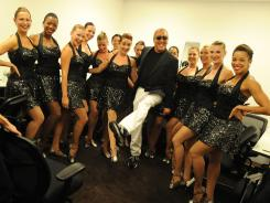 Designer Michael Kors celebrates Fashion's Night Out with the Rockettes at his newest Manhattan store.