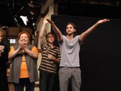 Thank you:  Ashton Kutcher takes a bow following the taping of the season's first new episode of  Two and a Half Men . Kutcher replaces Charlie Sheen; the rest of the cast is intact.
