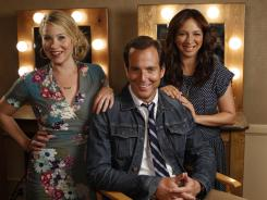 Personal experience:  Christina Applegate (mother of a 7-month-old), left, and Will Arnett (dad of two sons, ages 1 and 2) play new parents in NBC's  'Up All Night.' Maya Rudolph has the youngest child — her third was born in July — but she plays Applegate's childless boss.