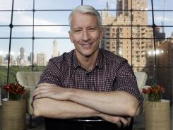 Anderson Cooper on the set of his new daytime talk show, 'Anderson.' Tuesday's episode shows him bench-pressing Kathy Griffin and chatting with Snooki.