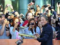 "Viggo Mortensen signs autographs for fans at the  ""Dangerous Method""   premiere Saturday at the Toronto International Film Festival."