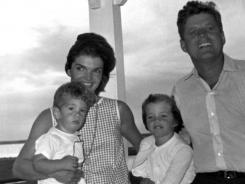 August 1962,  Hyannis Port, Mass.: President  Kennedy, Jacqueline, John Jr. and Caroline.