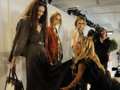 """Terrified"" but not showing it: Rachel Zoe adjusts model Nastasia Ohl's dress before her show Monday."