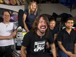 Foo do you think you are:  Dave Grohl, center, presides over a benevolent dictatorship with bandmates Chris Shiflett, left, Taylor Hawkins, Nate Mendel and Pat Smear.