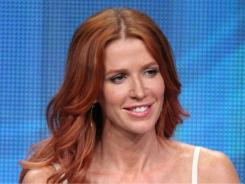 Actress Poppy Montgomery speaks during the 'Unforgettable' panel during the CBS portion of the 2011 Summer TCA Tour held at the Beverly Hilton Hotel on Aug. 3 in Beverly Hills, Calif.