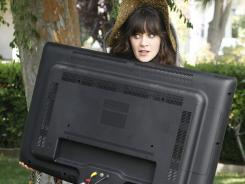 Don't worry, she's got it:  Zooey Deschanel's Jess moves in with three bachelors.