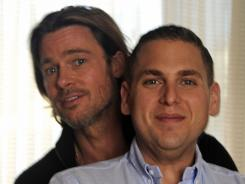 He's got his back:  Brad Pitt and Jonah Hill star in  Moneyball. It's the true-life story of Billy Beane, the man who revolutionized the way professional baseball players are evaluated.