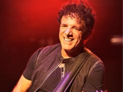 Journey guitarist Neal Schon finds himself back in the spotlight thanks to his new girlfriend, 'Real Housewives of DC' and White House party crasher, Michaele Salahi.
