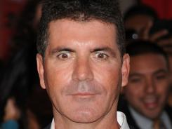 Simon Cowell's X Factor drew 12.5 million viewers in its Wednesday debut.