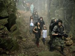 The Shannon family (Shelley Conn, left, Jason O'Mara, Naomi Scott, Landon Libiron and Alana Mansour) trek through the jungle.