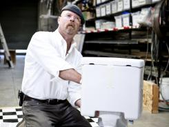 Have a seat:  Jamie Hyneman readies the toilet for the Lethal Weapon  2 experiment, in which the show will re-create the bathroom bomb scene from the 1989 hit movie.