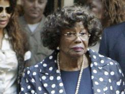 Michael Jackson's mother, Katherine, wept in court Tuesday when a recording of her son singing was played during the opening day of the manslaughter trial for Conrad Murray.