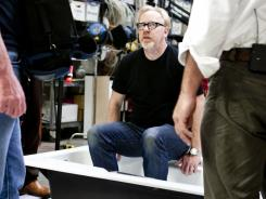 """We don't know what will happen when we start an experiment.,"" says  Adam Savage, center, on the bathroom set, preparing to re-create the 'Lethal Weapon 2' toilet-bomb scene."
