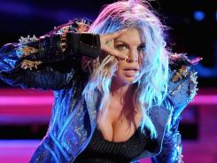 Fergie of the Black Eyed Peas performs in New York City on Sept. 30. The band has decided to drop out of the Michael Jackson tribute concert in Wales on Saturday.