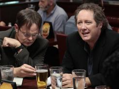 Rainn Wilson, left, and James Spader, who joins the cast this season as the new boss, Robert California.