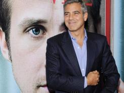 "Clooney attends the premiere of ""Ides of March"" at the Ziegfeld Theatre on Wednesday,   in New York."