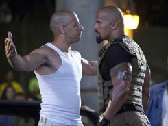 Corrupt agent Luke Hobbs (Dwayne Johnson), right, goes after Dom Toretto (Vin Diesel) in 'Fast Five.'