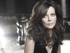'Eleven'  ways to love her:  Martina McBride brings grace and grit to her new album, which she's promoting on a train trip.
