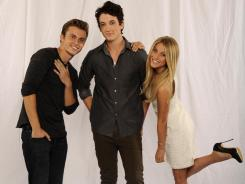Kenny Wormald, left, Miles Teller and Julianne Hough kick up their heels in the remake of 'Footloose.'