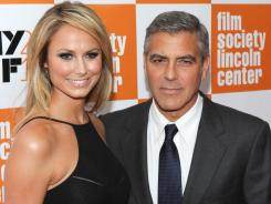 George Clooney and girlfriend Stacy Keibler walk the red carpet on their way into the Closing Night Gala Presentation of 'The Decendants' at the 49th New York Film Festival.