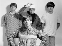 The Stone Roses: Mani, from left, Reni, John Squire, and Ian Brown (seated in foreground).