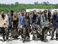 Coming on strong:  The 'Walking Dead'  zombies built on last year's Halloween debut.