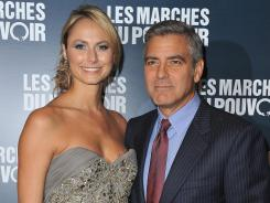 Stacy Keibler and  George Clooney attend  'The Descendants'  premiere in Paris.
