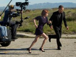 Amanda Seyfried and Justin Timberlake film a scene from the sci-fi thriller.