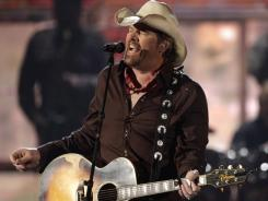 Toby Keith, who performed at April's Academy of Country Music Awards, sings a lot on his new album about bars and the people who frequent them.