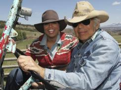 Oprah Winfrey rides in a jeep with Ralph Lauren at his ranch outside Telluride, Colo.