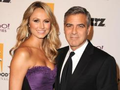 Stacy Keibler and George Clooney attend the 15th Annual Hollywood Film Awards in Beverly Hills, Calif.