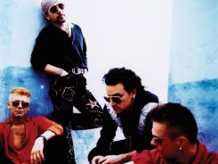 U2 in 1991:  Adam Clayton, left, The Edge, Bono and Larry Mullen.