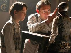 Jude Law, right, and Asa Butterfield star in 'The Invention Of Hugo Cabret,' an adaptation of Brian Selznick's prize-winning book.