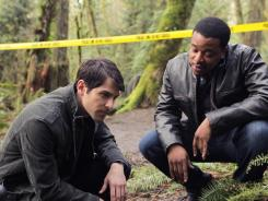 Not afraid of the big bad wolf are the modern-day Grimm, Nick (David Giuntoli, left), and his partner Hank (Russell Hornsby).