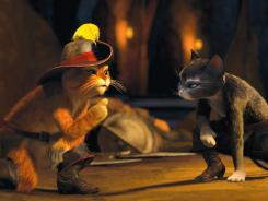 Puss In Boots (voiced by Antonio Banderas) and Kitty Softpaws (voiced by Salma Hayek) join forces in the animated film 'Puss In Boots.'