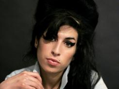 Amy Winehouse died with empty vodka bottles in her room and lethal amounts of alcohol in her blood , more than five times the British drunk driving limit, a British coroner ruled.