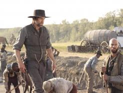 Cullen Bohannon (played by Anson Mount) and Elam Jefferson (Common) form an uneasy friendship while working on the railroad on AMC's 'Hell On Wheels.'
