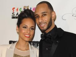 Alicia Keys and her music producer husband Swizz Beatz hug it out on the red carpet at the Keep A Child Alive's 8th annual Black Ball in New York Thursday.