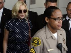 Actress Lindsay Lohan leaves a probation hearing at Los Angeles Superior Court Wednesday, Nov. 2, 2011.