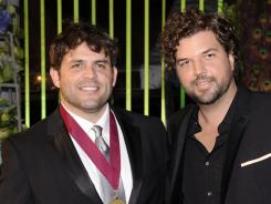 Songwriters Rhett Akins, left, and Dallas Davidson each had five of the year's most-performed country songs.