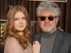 Amy Adams and Pedro Almodovar announce Morgan Freeman as the recipient of the Cecil B. DeMille Award on Wednesday. Freeman will be honored at the 69th annual Golden Globe Awards.