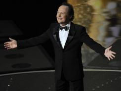 "When Billy Crystal took the stage at the 2011 awards, it wasn't as the host, a gig he hasn't had since 2004. But he said over the summer that he was ""itching"" to do it again."