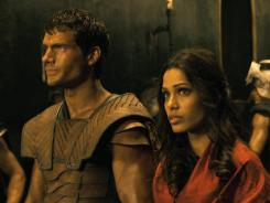 Henry Cavill, left, and Freida Pinto travel back to ancient Greece in 'Immortals.'