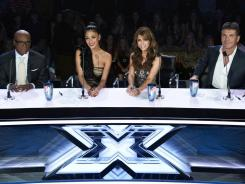 Judges L.A. Reid, left, Nicole Sherzinger, Paula Abdul and Simon Cowell pass judgment in Week 2 of 'X Factor.'