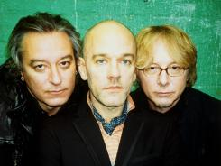 Following news of disbanding in September, R.E.M.'s Peter Buck, left, Michael Stipe and Mike Mills are releasing a 40-song retrospective of their career this week.