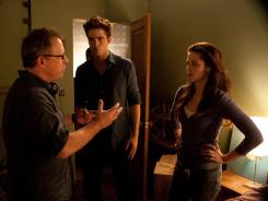 Director Billl Condon, left, discusses a scene with Robert Pattinson and Kristen Stewart on the set of 'The Twilight Saga: Breaking Dawn - Part 1.'
