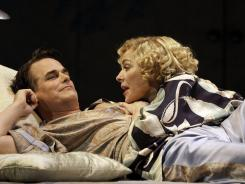 Paul Gross and Kim Cattrall play ex-spouses who rekindle a spark while on separate honeymoons in the Broadway revival of Private Lives .
