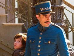 Baron Cohen plays a train station inspector who pursues Hugo Cabret (Asa Butterfield) in 'Hugo.'