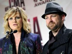 Jennifer Nettles and Kristian Bush of Sugarland face legal action related to the August stage collapse at the Indiana State Fair that killed seven people.