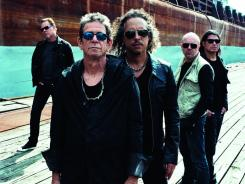 Bay Area heavy metal giant Metallica and New York avant-garde rocker Lou Reed teamed up to produce a concept album out Wednesday.